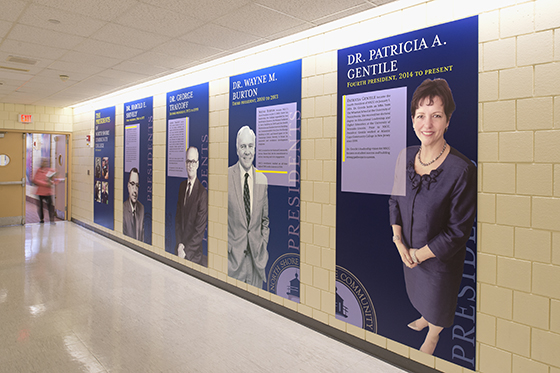 Hallway with large panels of students on the walls