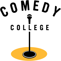 Lone microphone in a spotlight with Comedy College type in front of the microphone